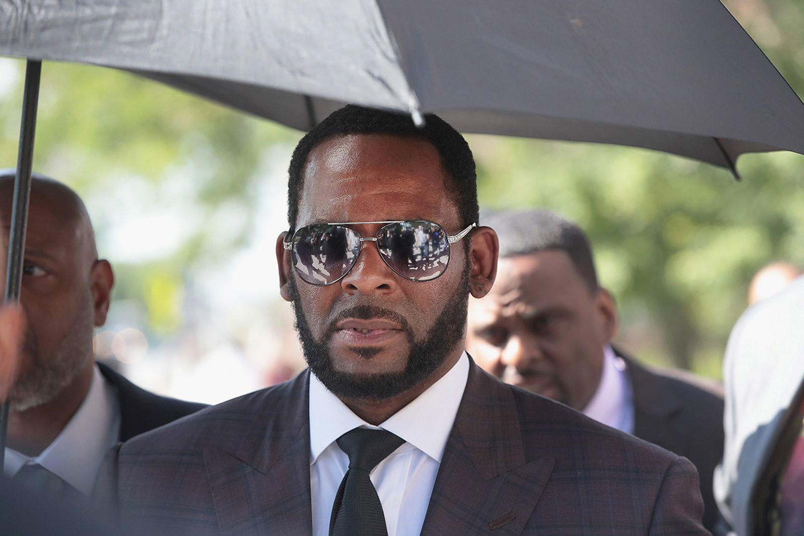 R. Kelly suit tie sunglasses