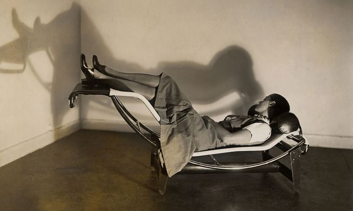 Charlotte perriande on a chaise longue