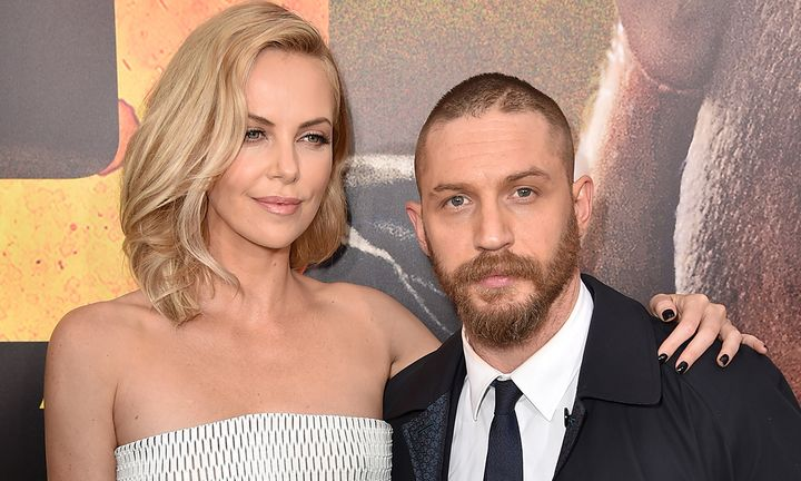 "Charlize Theron (L) and Tom Hardy attend the premiere of Warner Bros. Pictures' ""Mad Max: Fury Road"""