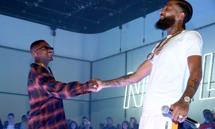 YG (L) and Nipsey Hussle perform