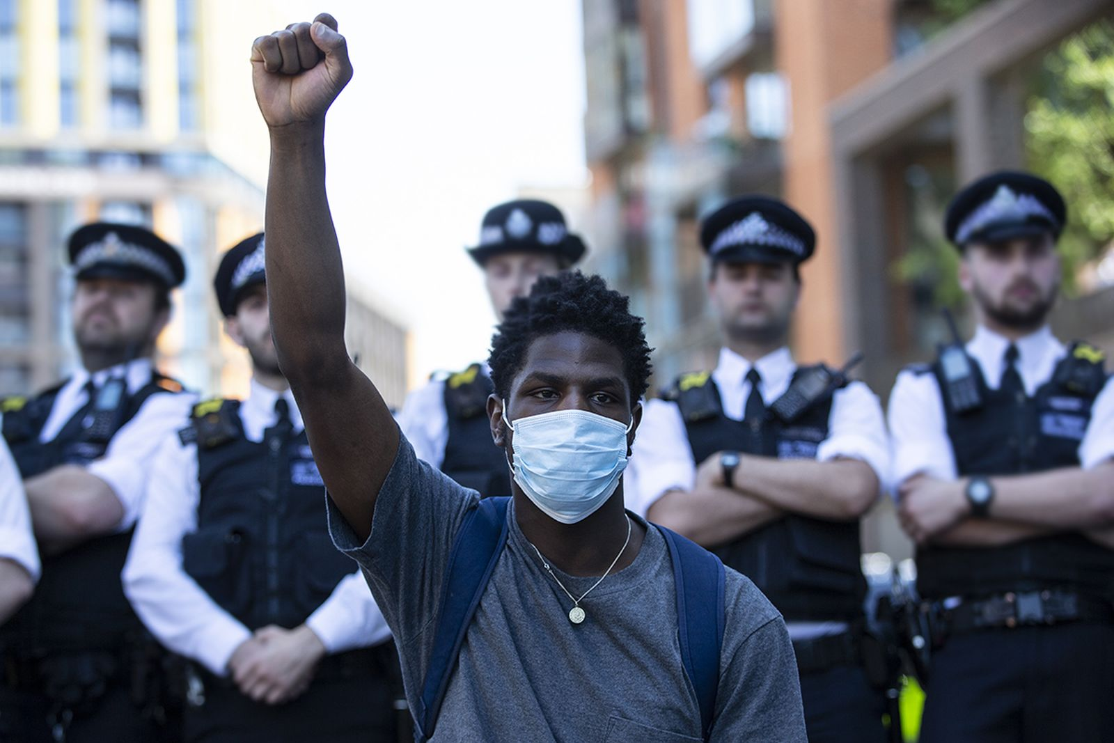 people join in a spontaneous Black Lives Matter march through central London to protest the death of George Floyd