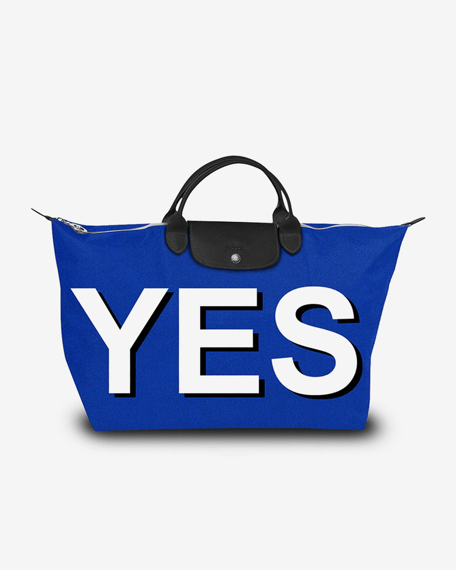 "Longchamp bag with ""YES"" in capital letters"