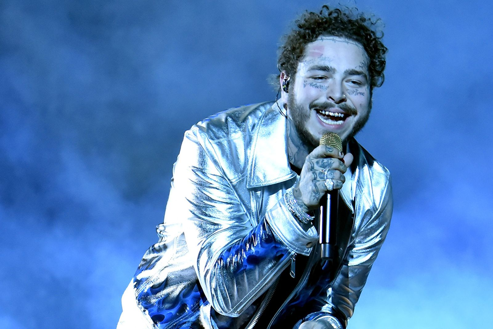 Post Malone performs onstage during the 2018 American Music Awards