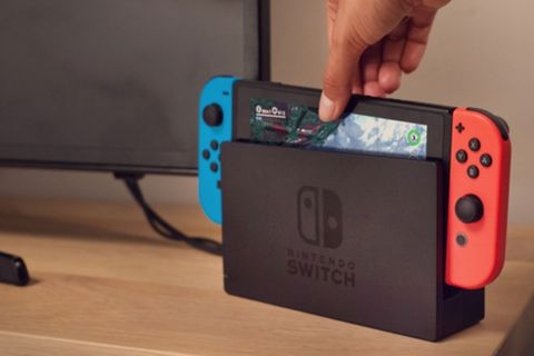 hand holds nintendo switch