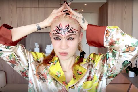 Grimes does her makeup for vogue