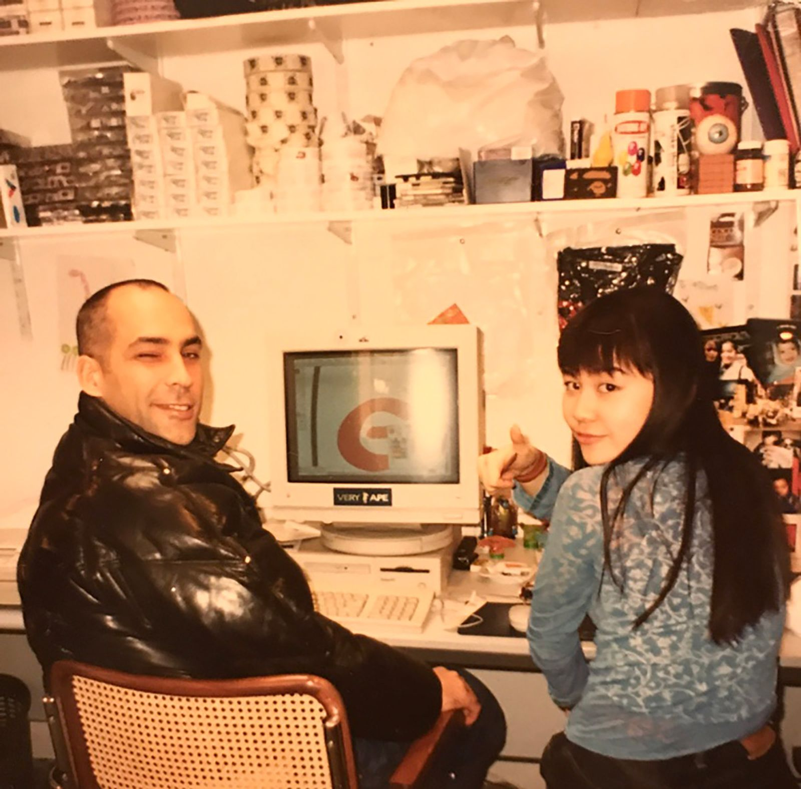 Hitomi Yokoyama with James Lebon sitting in front of a computer
