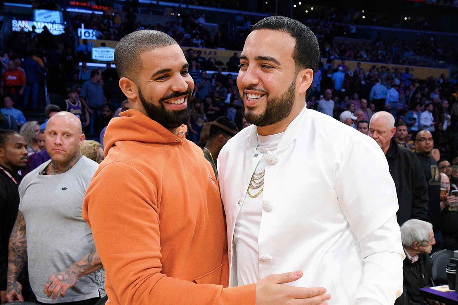 Drake and French Montana hugging court-side