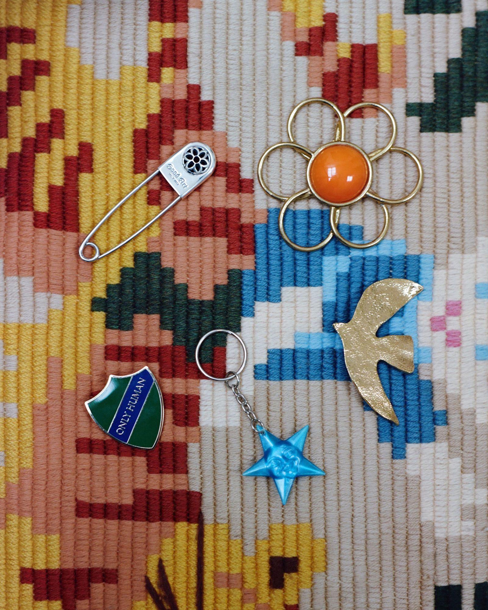 PinGOOD ART HLYWD, FlowerSTYLIST'S OWN, Bird brooch CECILE ET JEANNE, Star keyringEBAY, Only human school badgeTHAMES MMXX