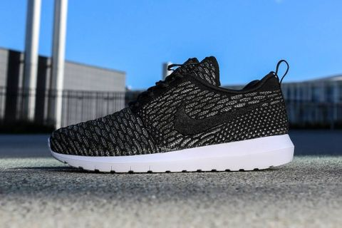 "premium selection 49db8 eaf92 Following the ""Fireberry"" and ""Neon Turqouise"" colorways, Nike is releasing  a ""Black Sequoia"" rendition of its new Roshe Run Flyknit silhouette."