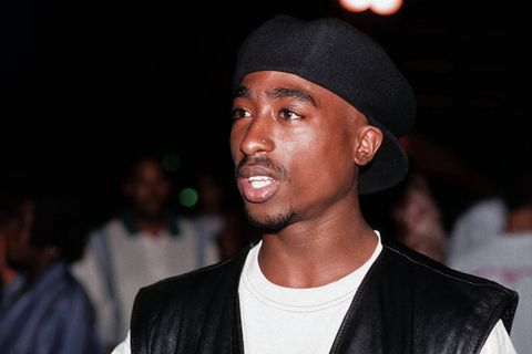 Tupac Shakur poses for a portrait at Club Amazon