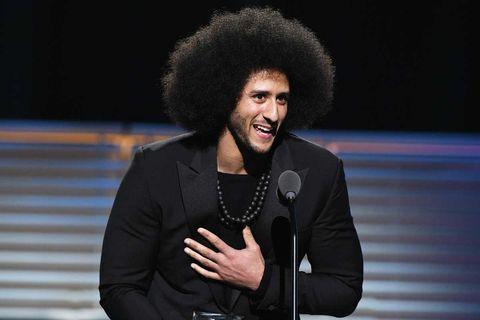 Colin Kaepernick receiving the Sports Illustrated Muhammad Ali Legacy Award