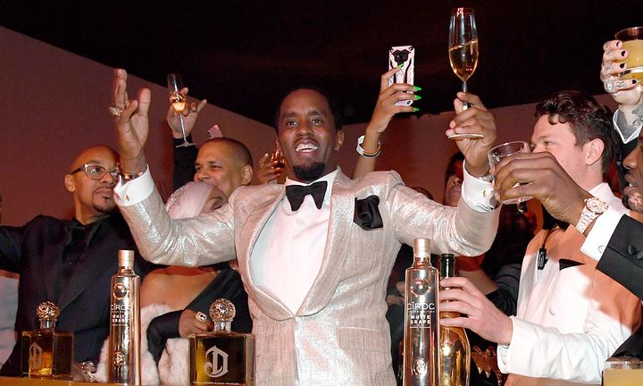 diddy toasting at his birthday bash
