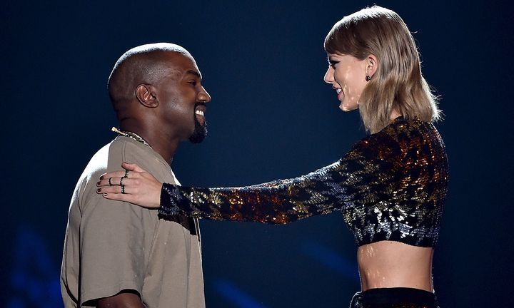 Kanye West accepts the Video Vanguard Award from recording artist Taylor Swift
