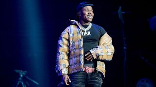 DaBaby onstage wearing Burberry puffer