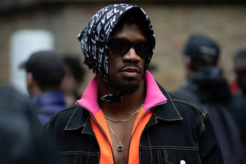 Man Wearing Sunglasses and Head Scarf