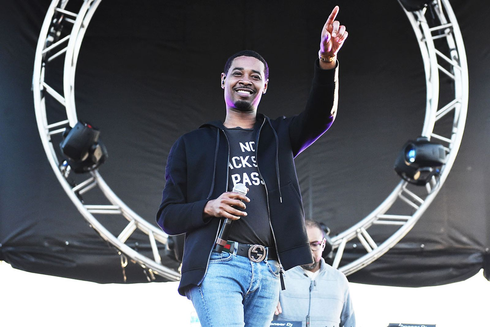 Danny brown performs wearing black blazer, tee and jeans