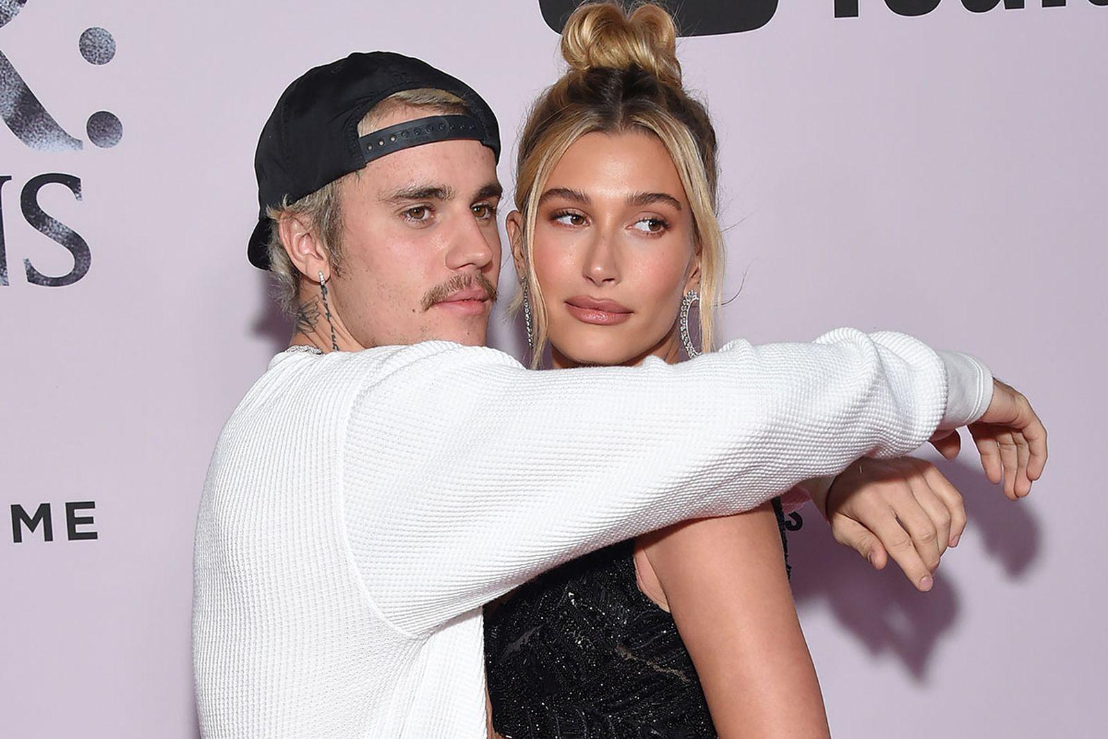 "Justin Bieber (L) and wife US model Hailey Bieber arrive for YouTube Originals' ""Justin Bieber: Seasons"" premiere"