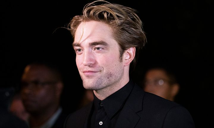 Robert Pattinson on the red carpet, black background