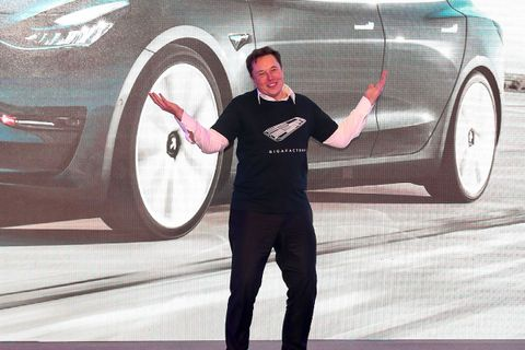 Elon Musk shrugs onstage