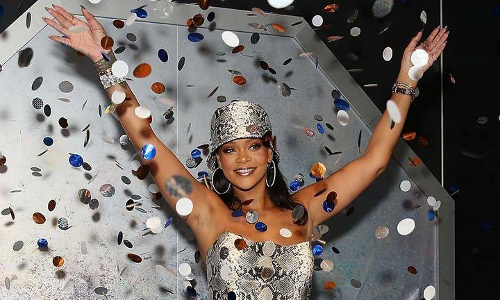 Rihanna smiling at the Fenty Beauty party
