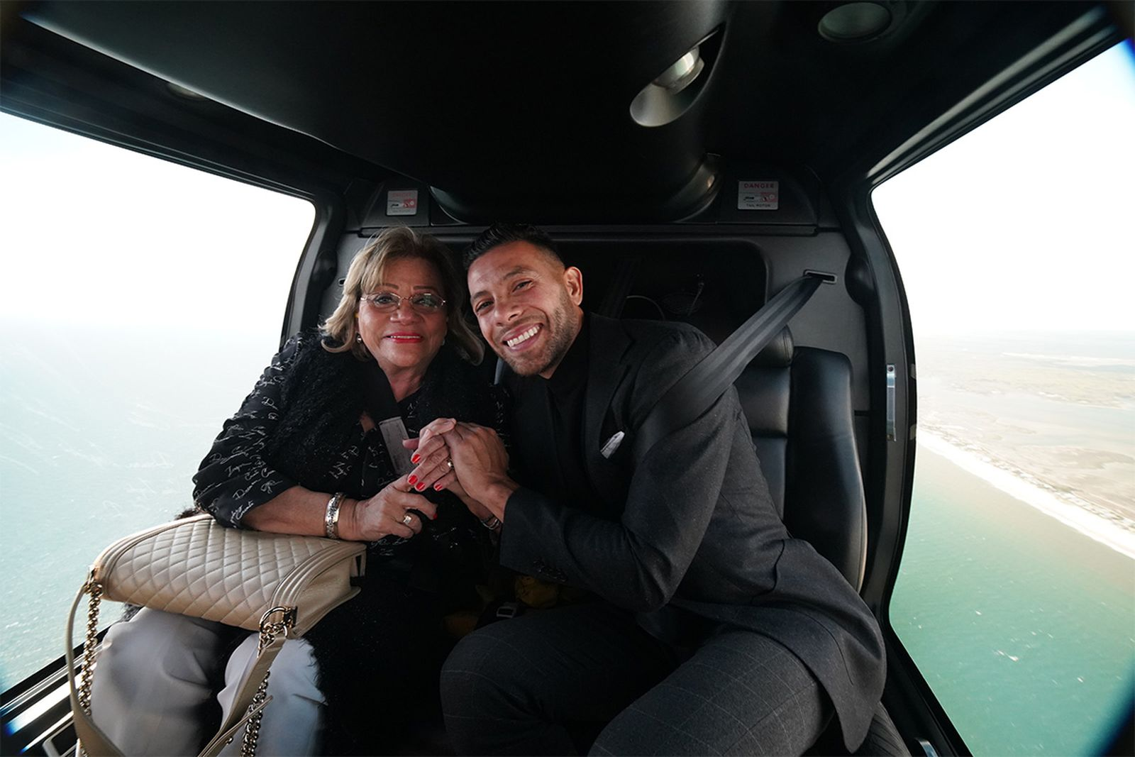 Entrepreneur Gerard Adams with his mother enjoying a BLADE flight.
