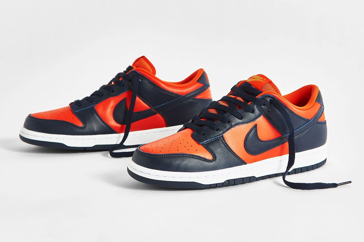 navy and orange nike dunk low champ colors product shot