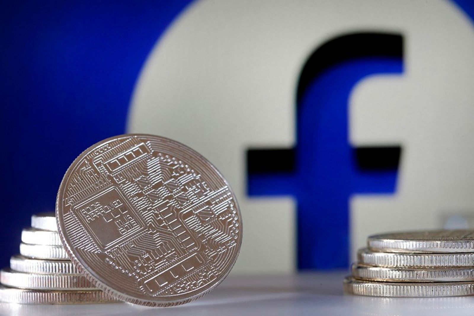facebook icon behind stack of coins