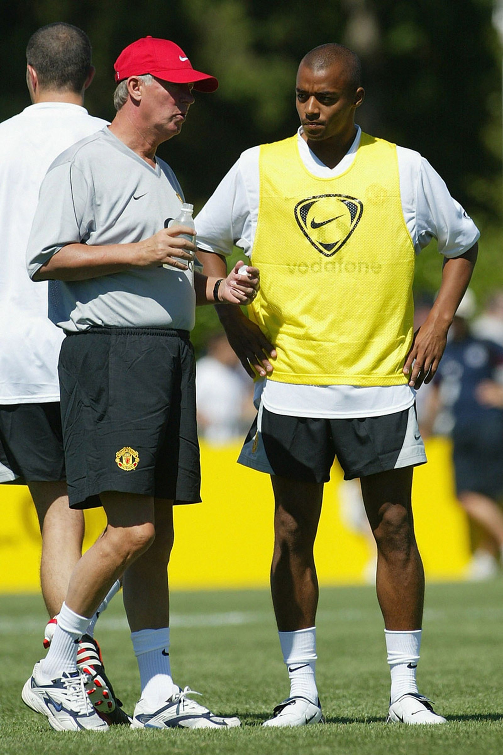 Sir Alex Ferguson of Manchester United talks with new signing David Bellion during their first training session of their American Tour on July 20, 2003.