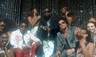 "Watch Gucci Mane, Bruno Mars, & Kodak Black Glow Up in ""Wake Up In the Sky"" Video"