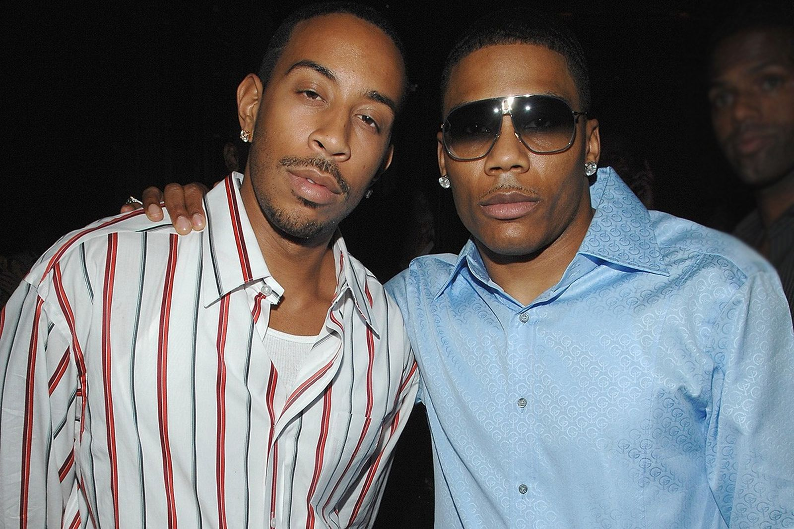 Nelly and ludacris pose at ushers fragrance launch