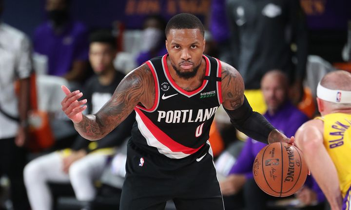 Damian Lillard #0 of the Portland Trail Blazers handles the ball against the Los Angeles Lakers during Round One, Game One of the NBA Playoffs