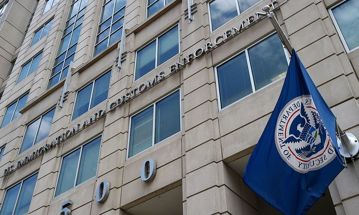 The Department of Homeland Security flag flies outside the Immigration and Customs Enforcement (ICE) headquarters