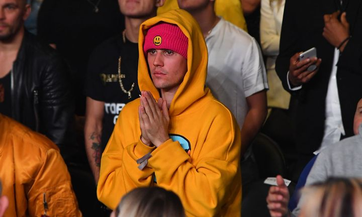 Justin Bieber stands amid crowd