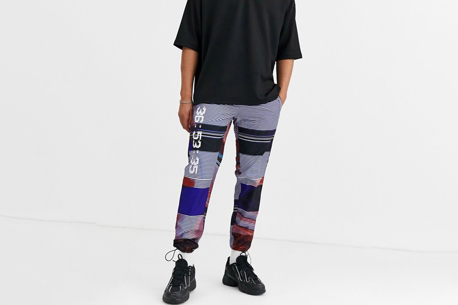 Tapered Pants In All Over Text Print