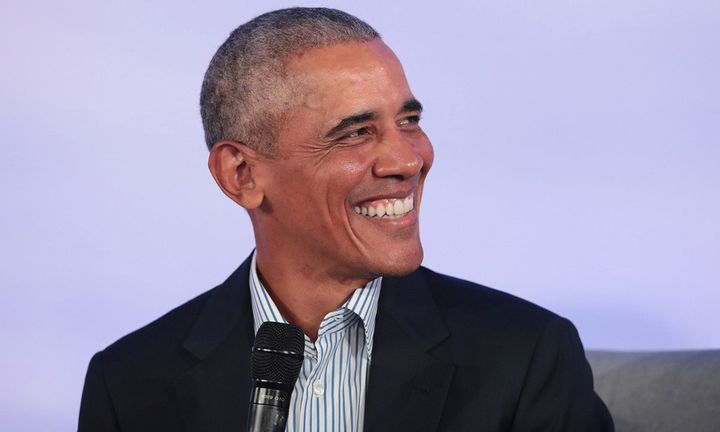 barack obama smiling purple background