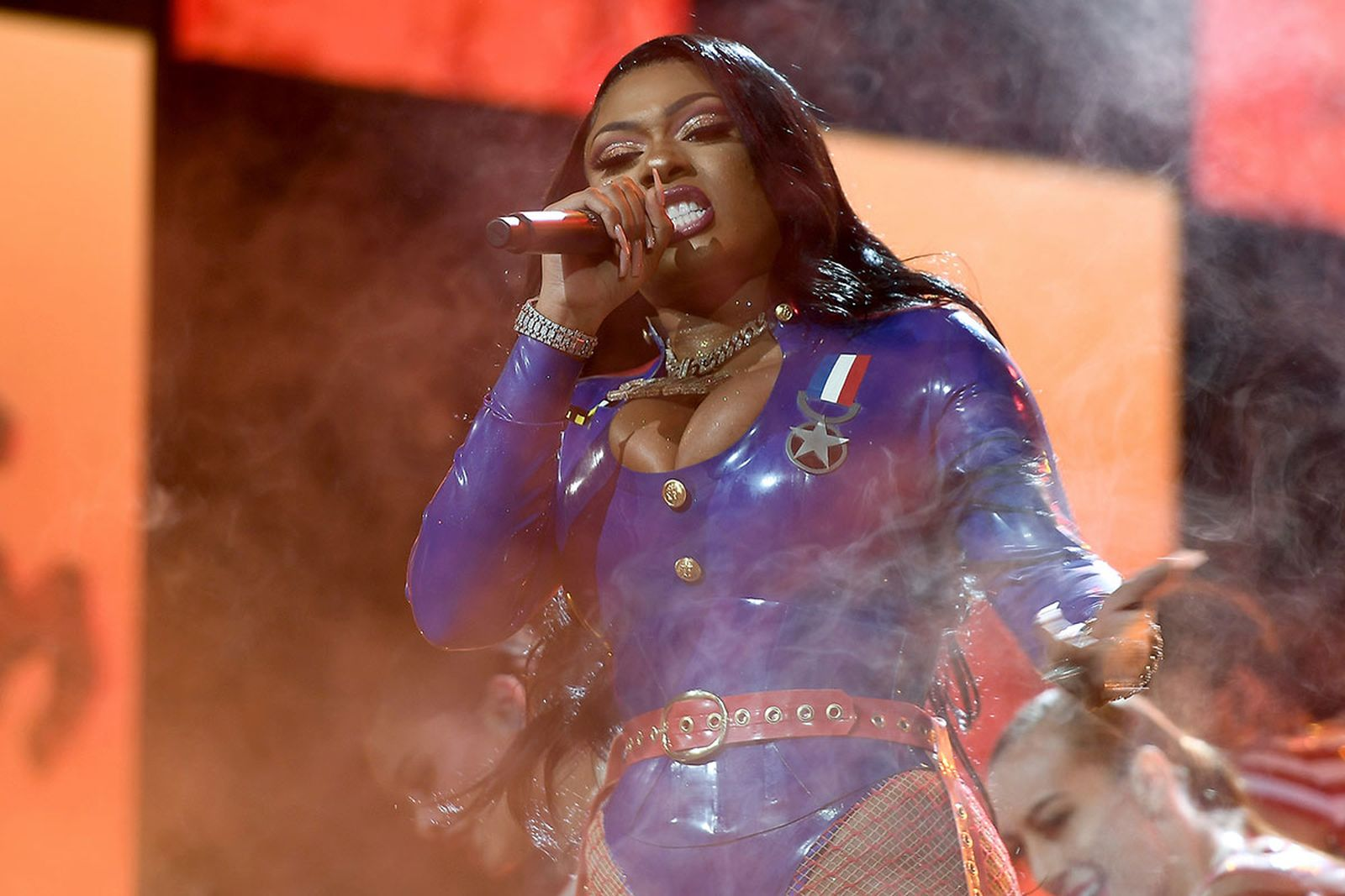 Megan thee stallion performs blue latex outfit