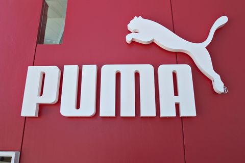 puma best ever quarter sales profit Adidas Nike