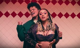 "Cardi B & Bruno Mars' Chemistry Is Undeniable in Video for ""Please Me"""