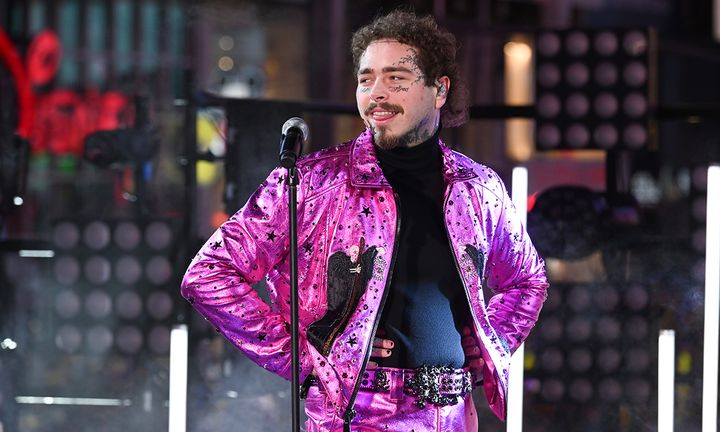 Post Malone performing pink jacket