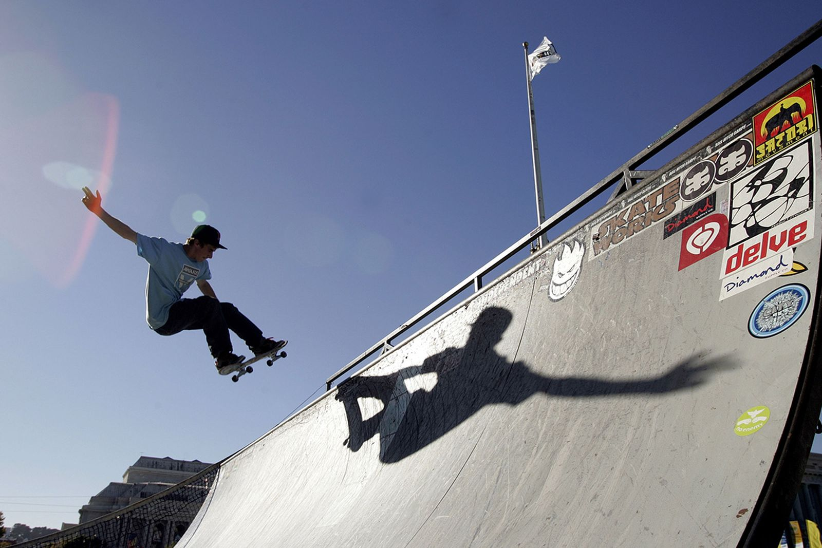 A skateboarder rides a ramp outside the World Cyber Games