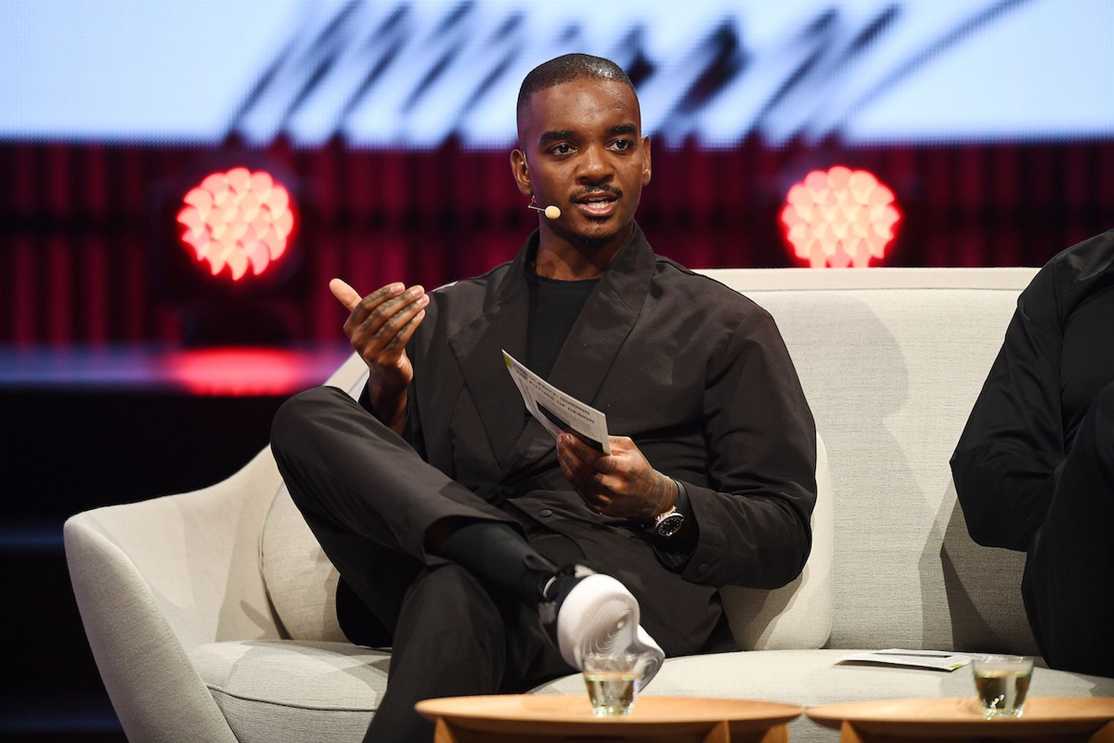 COPENHAGEN, DENMARK - MAY 16: Samuel Ross, Founder and Designer, A-Cold-Wall,  takes part in the 'sustainability and design decisions: good, bad or ugly?' Panel Discussion during Day Two of the Copenhagen Fashion Summit 2019 at DR Koncerthuset on May 16, 2019 in Copenhagen, Denmark. Since its first edition in 2009, Copenhagen Fashion Summit has established itself as the world's leading business event on sustainability in fashion. Convening major fashion industry decision makers on a global scale, the Summit has become the nexus for agenda-setting discussions on the most critical environmental, social and ethical issues facing our industry and planet. Marking its 10th anniversary, the next edition of Copenhagen Fashion Summit takes place on 15-16 May 2019 at the Copenhagen Concert Hall under the patronage of HRH The Crown Princess of Denmark. The Summit is organised by Global Fashion Agenda, a non-profit leadership forum on fashion sustainability that works to mobilise the global fashion system to change the way we produce, market and consume fashion, for a world beyond next season. (Photo by Lars Ronbog/Getty Images for Copenhagen Fashion Summit)