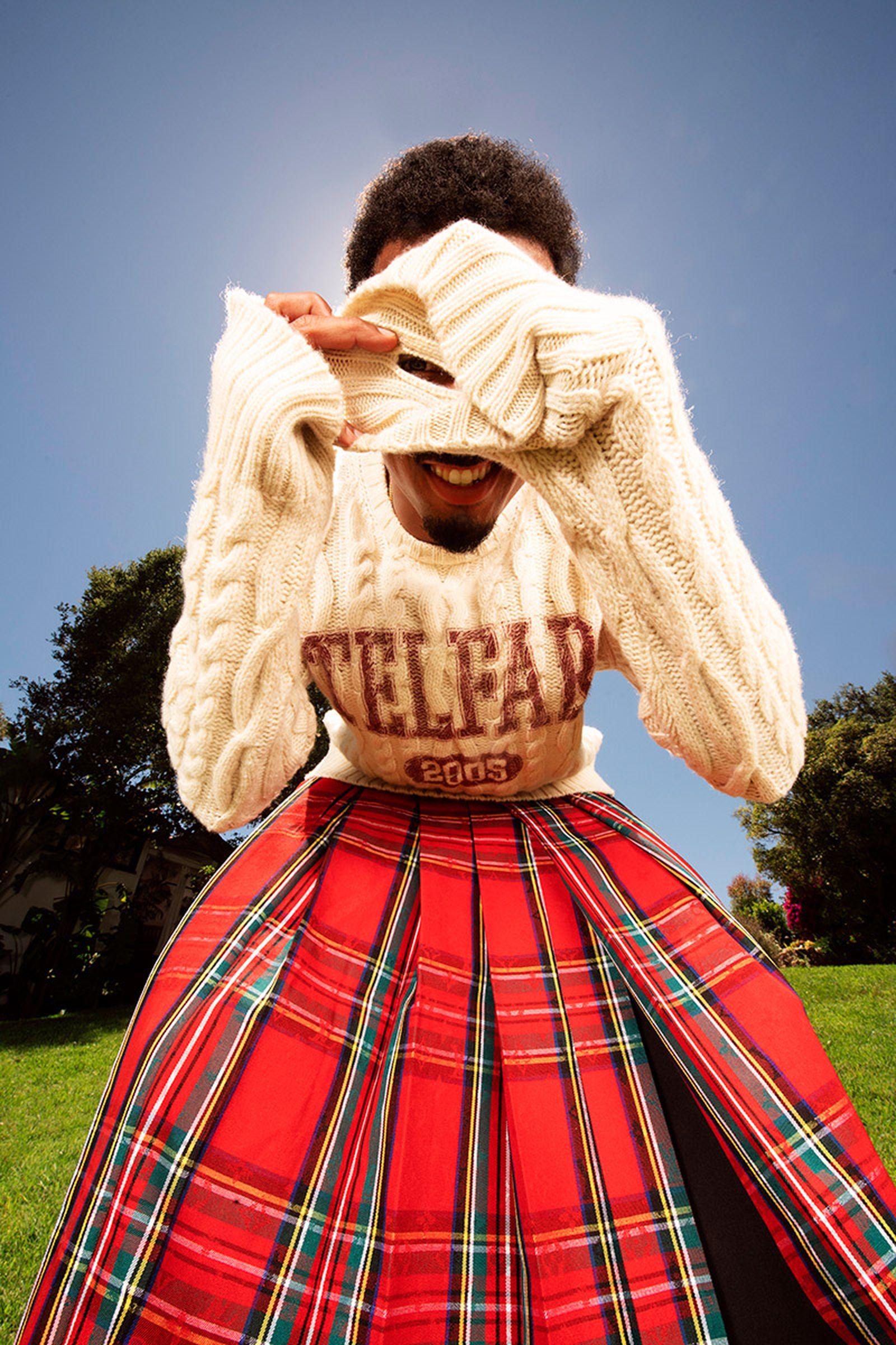 Sweater, Pants, and Loafers TELFAR, Blazer and Kilt Skirt LOUIS VUITTON