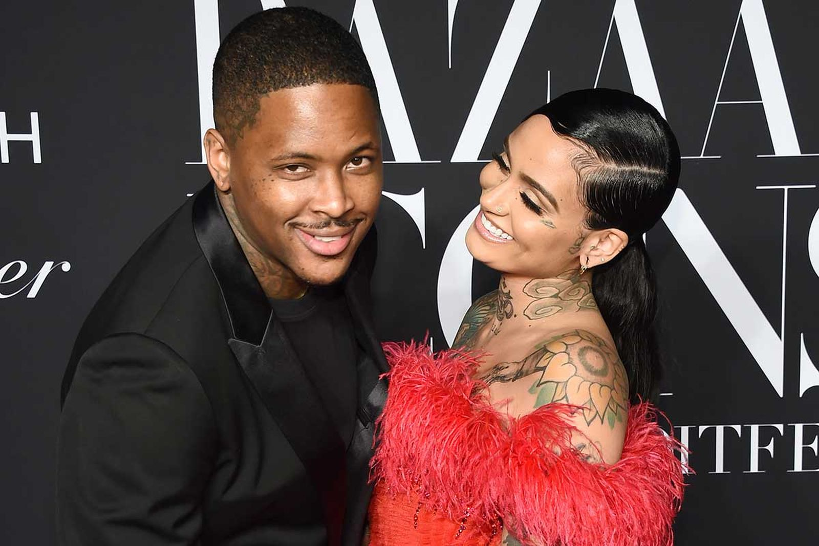 YG and Kehlani smiling on the red carpet