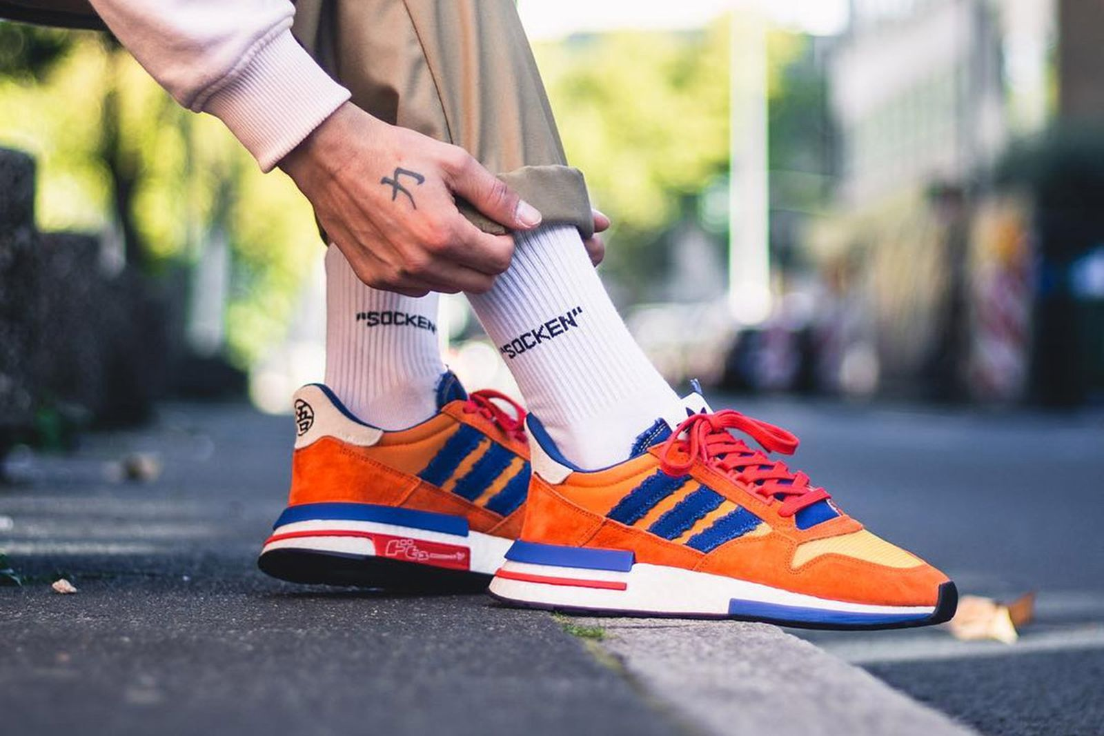 A través de Corchete Arquitectura  How People Are Wearing the 'Dragon Ball Z' x adidas Collab
