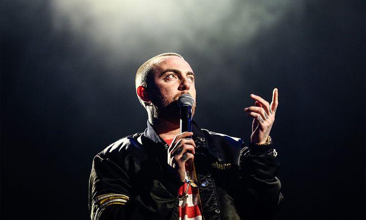 Mac miller performing microphone black jacket