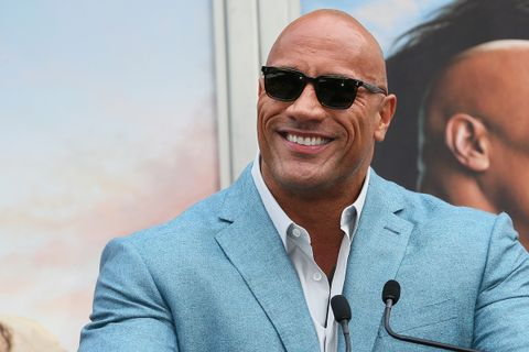 Dwayne Johnson attends a Hand and Footprint ceremony honoring Kevin Hart