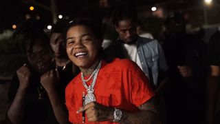 young m.a smiling orange t-shirt