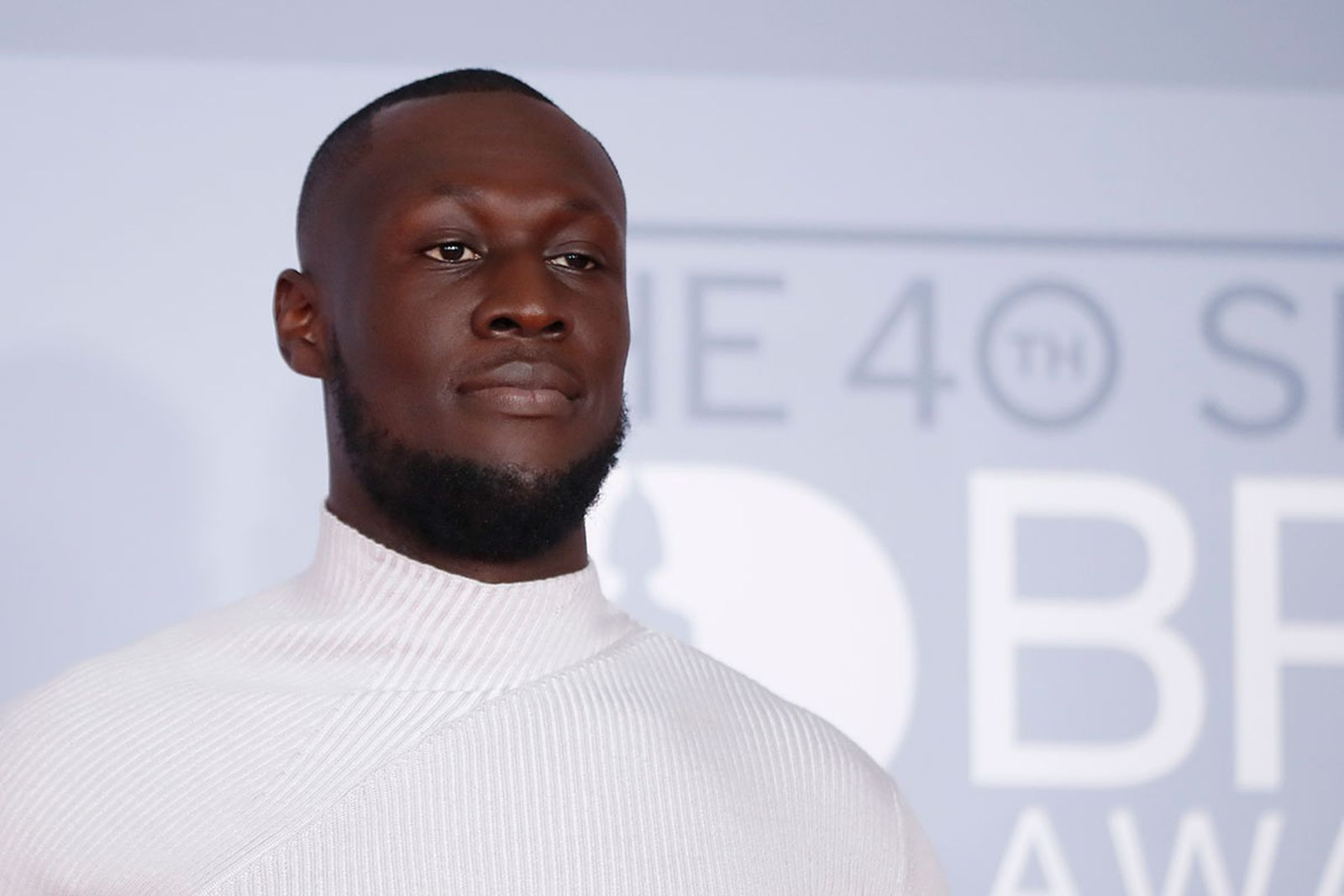Stormzy poses on the red carpet on arrival for the BRIT Awards 2020