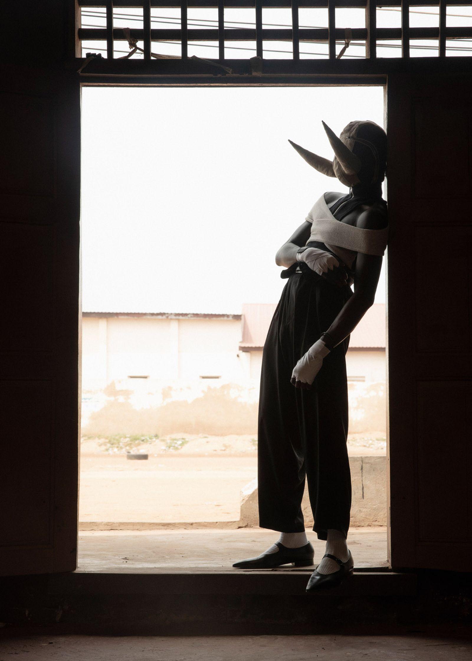 KWABENA Top and belt GMBH Pants YOHJI YAMAMOTO Socks CELINE Shoes MAISON MARGIELA