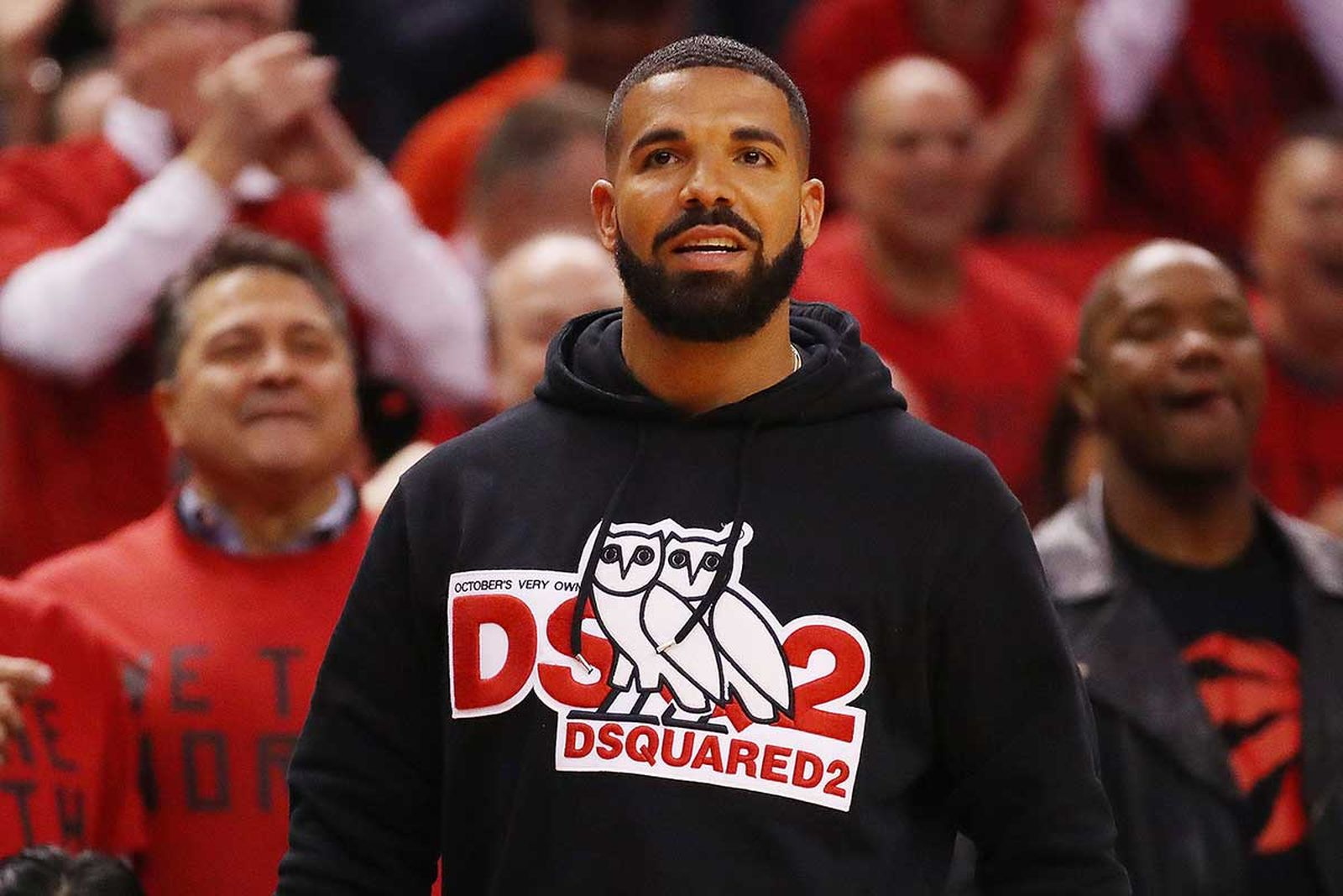 Drake wearing an OVO x DSQUARED2 hoodie